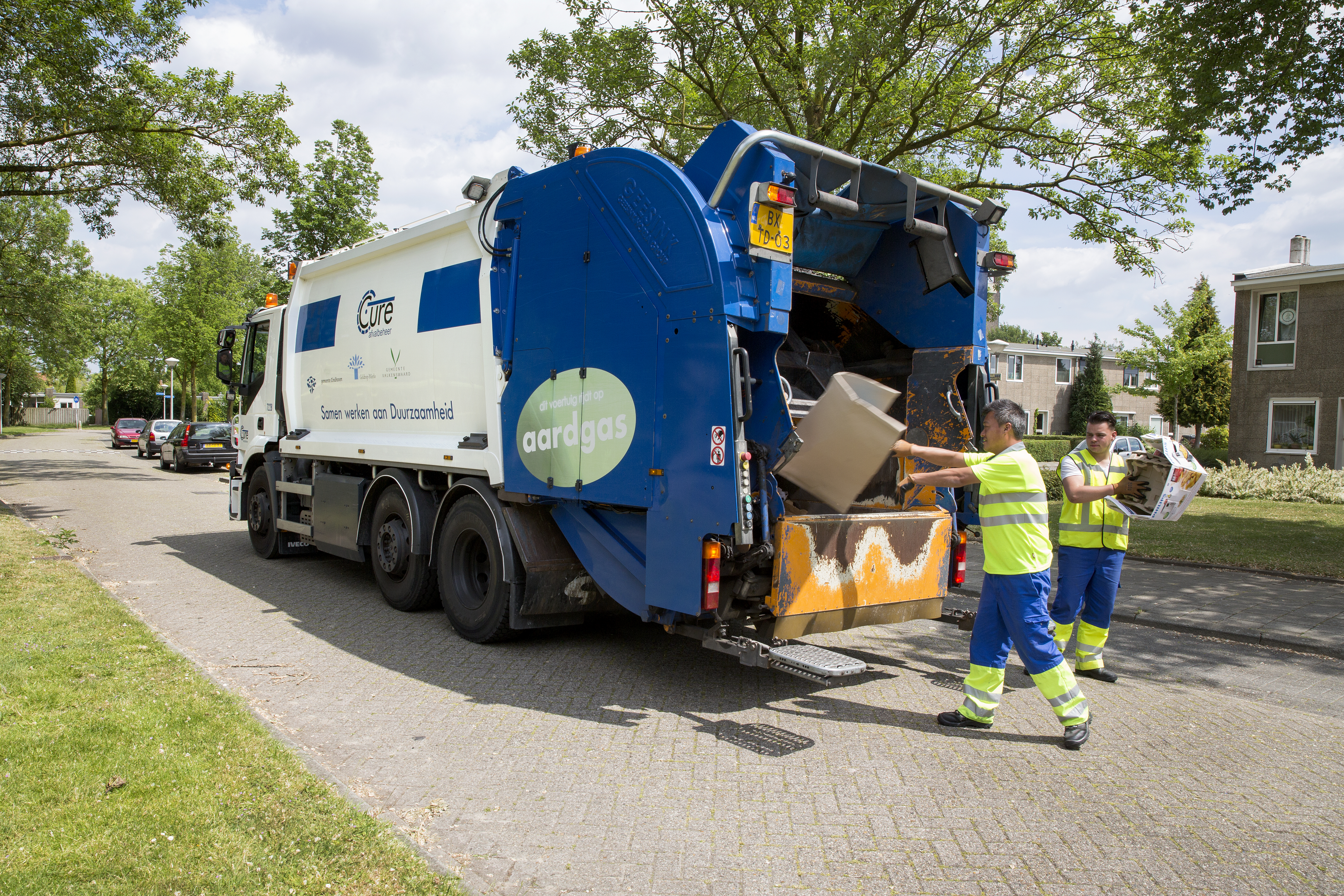 Garbage truck with two garbage collectors